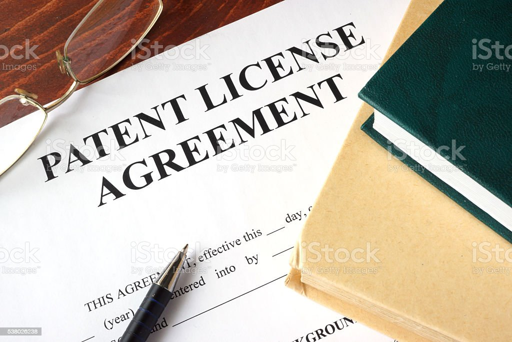 Patent License agreement on a table. Copyright concept. stock photo