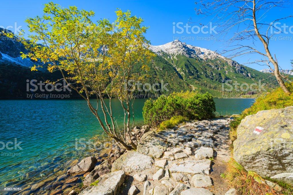 Path along Morskie Oko alpine lake in autumn colours, High Tatra Mountains, Poland stock photo
