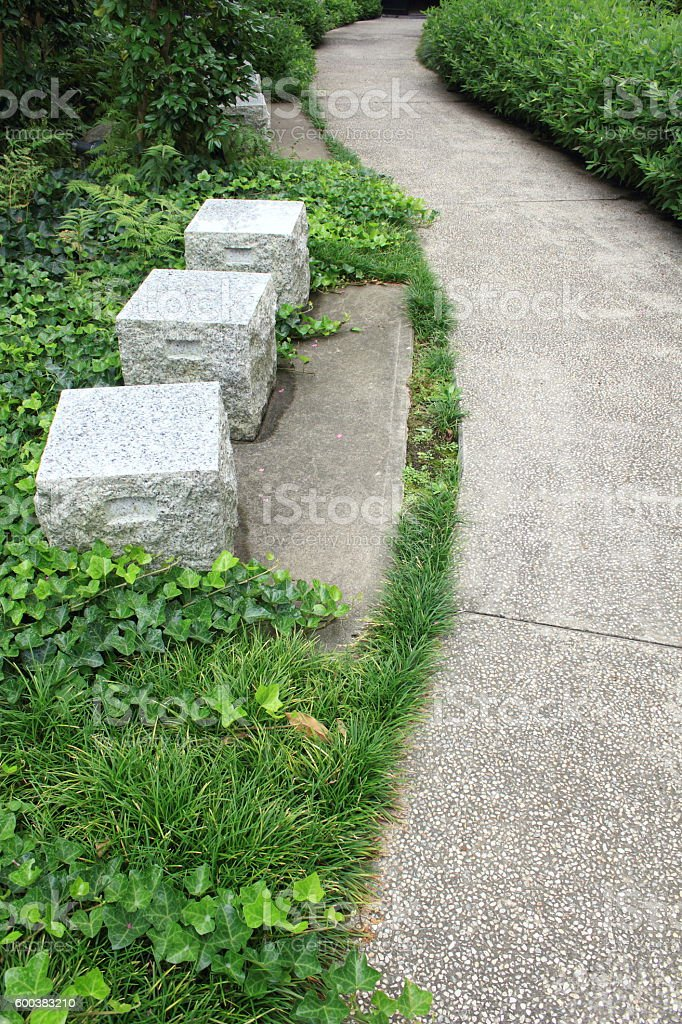Path and stone benches in Japanese garden stock photo