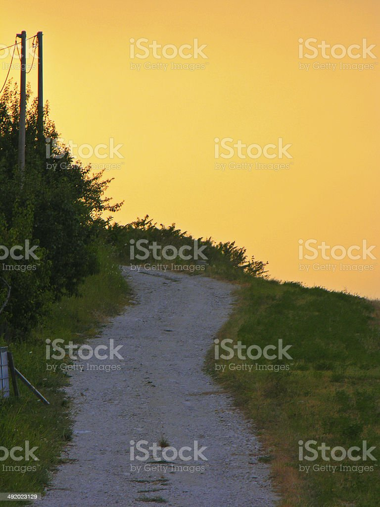 Path going to nowhere in middle Italy during a sunset stock photo