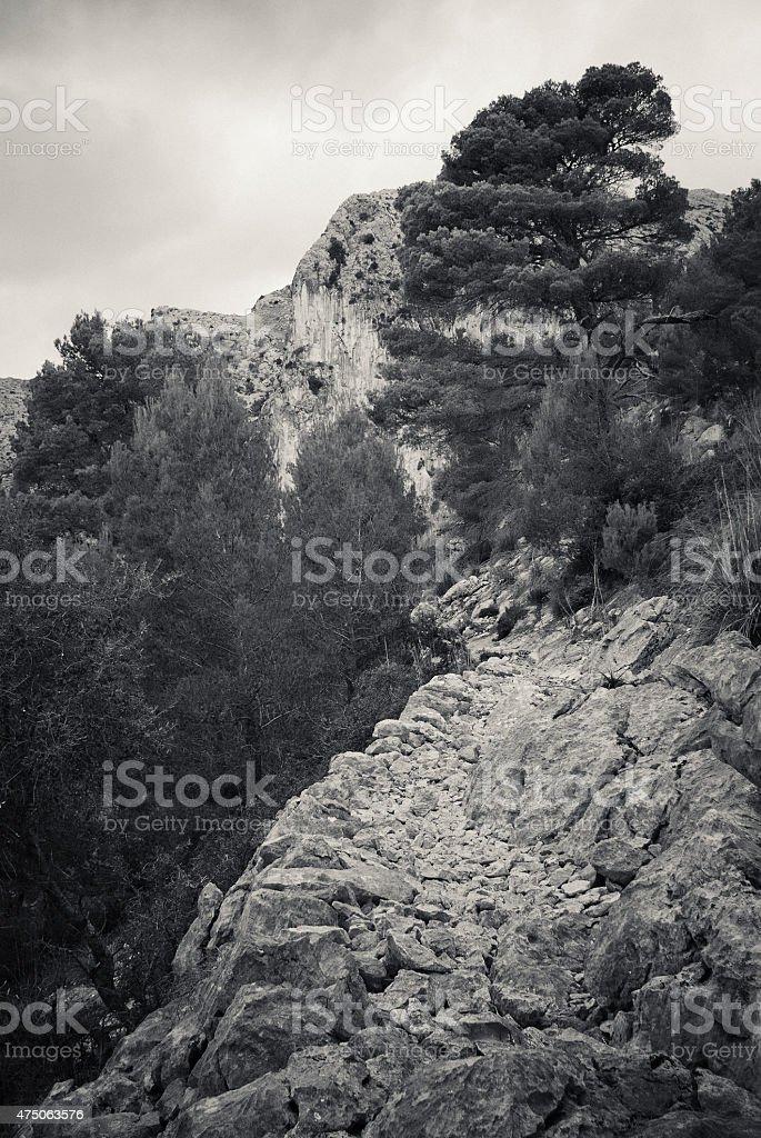 Path leading along the edge of a mountain on Majorca stock photo