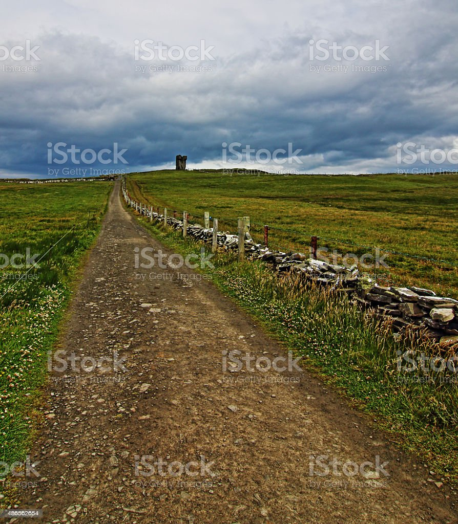 Path leading to Moher Tower along the Cliffs of Moher stock photo
