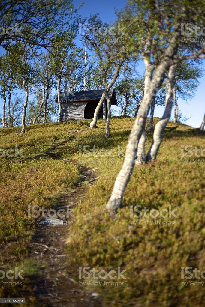 Path leading up to a resting hut stock photo