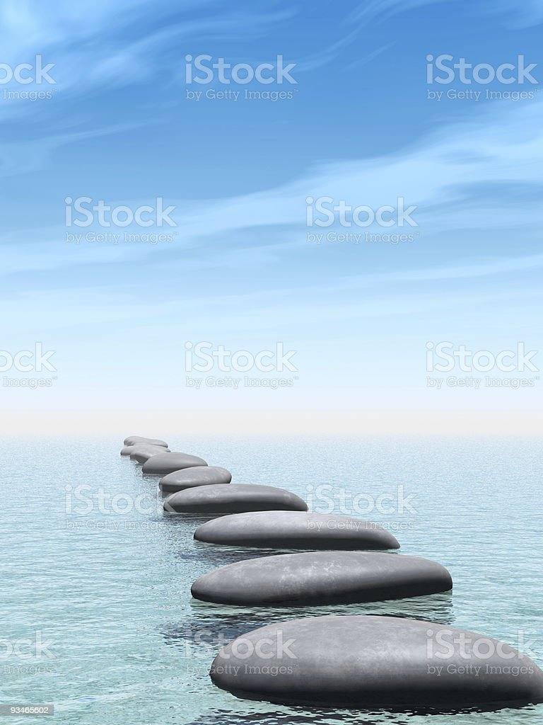 A path of smooth rocks across some water stock photo