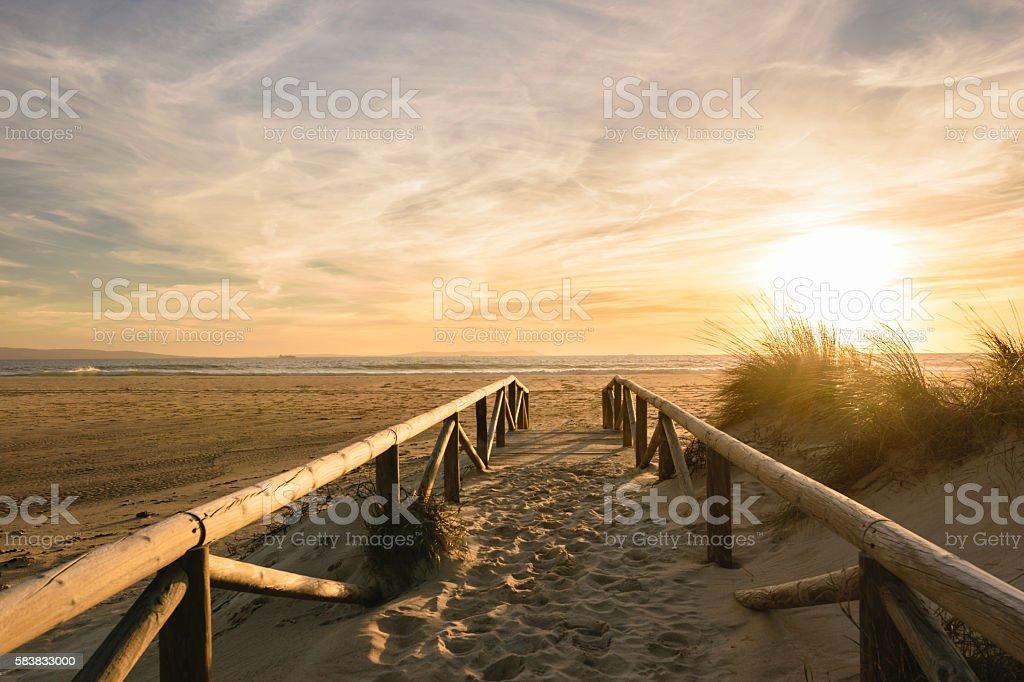 Path on sand at sunset, Tarifa, Spain stock photo