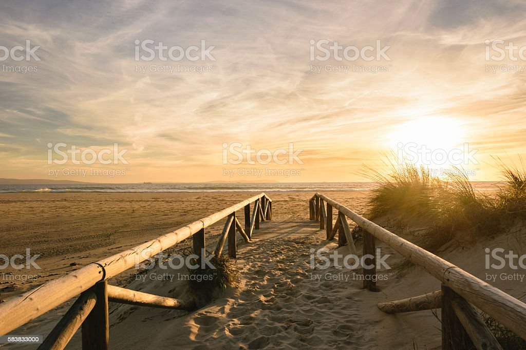 Path on sand at sunset, Tarifa, Spain stock photo