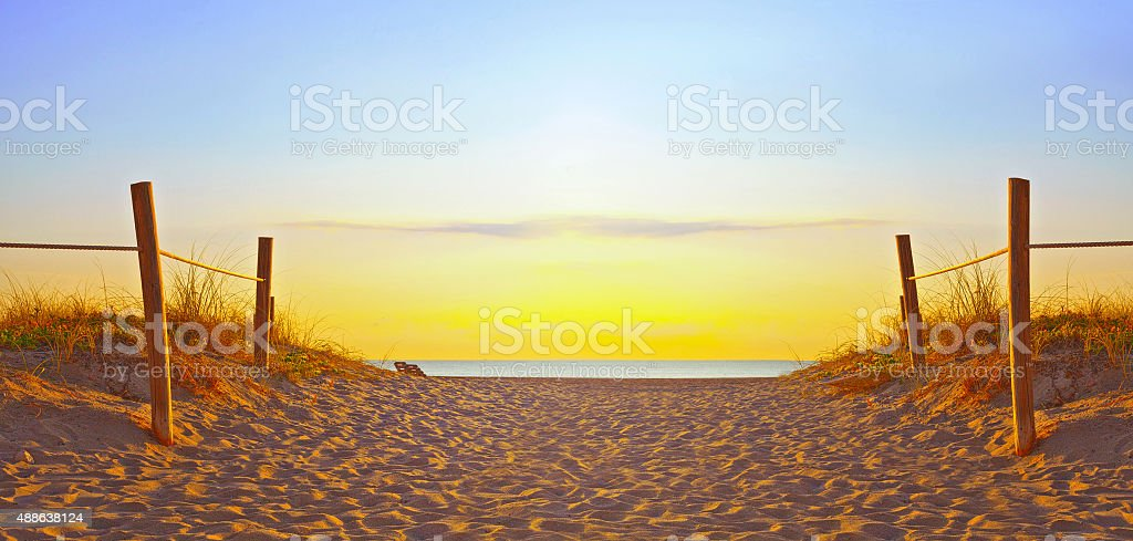 Path on the sand going to the ocean in Miami Beach stock photo