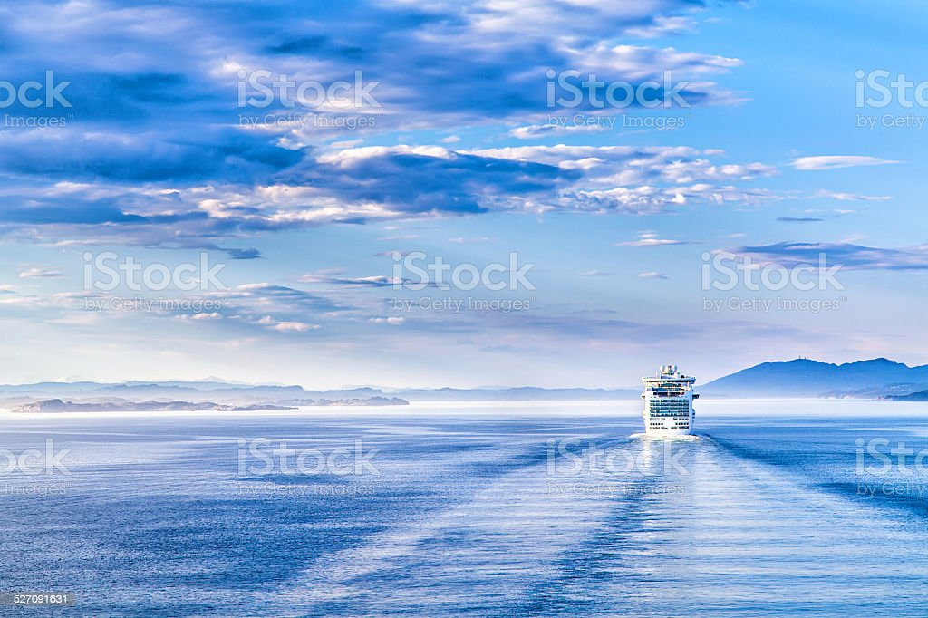 Path on the water from a large cruise ship stock photo