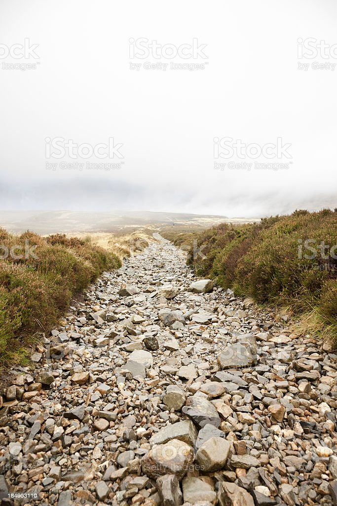 Path Over Foggy Scottish Moors stock photo