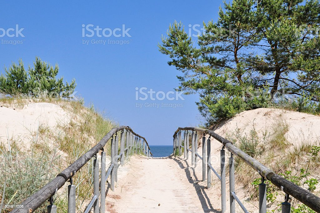 Path through dunes to the beach at Baltic Sea stock photo