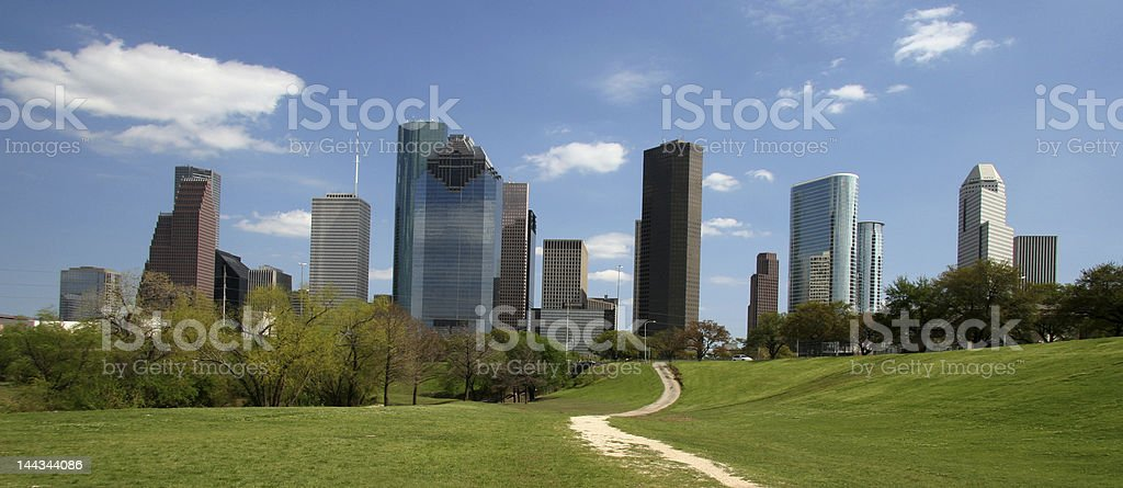 Path through the park leading to the heart of downtown stock photo