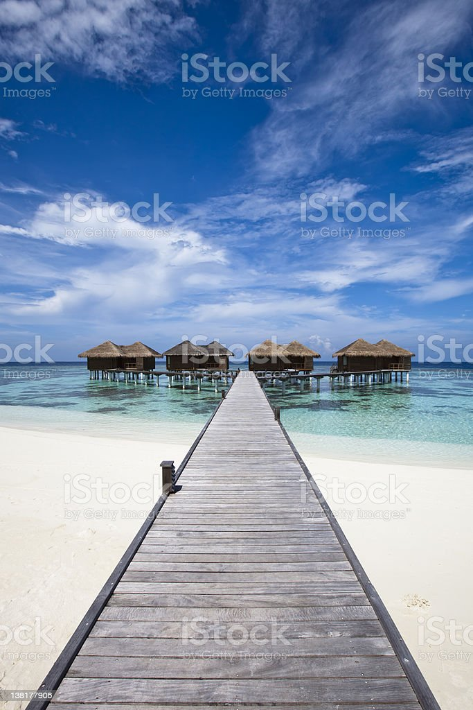 Path to sea tents at beach scenery stock photo