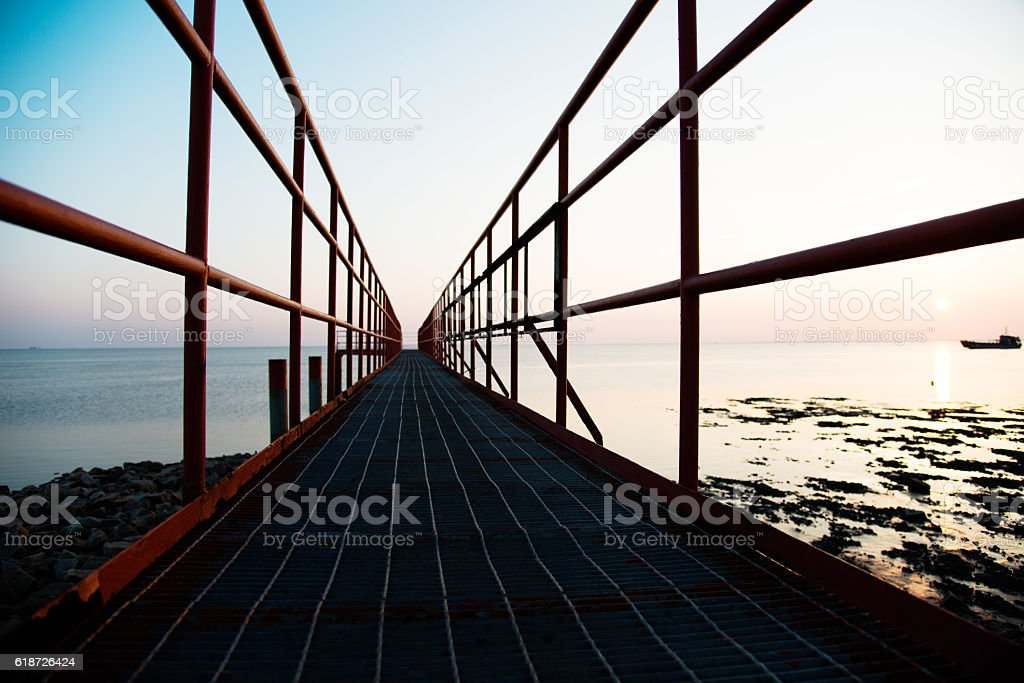Path to the sea at sunset stock photo