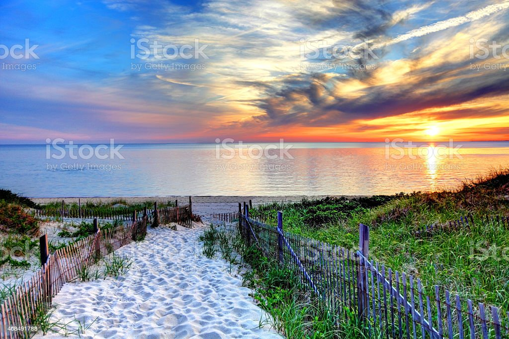 Path with beach fence on Cape Cod stock photo