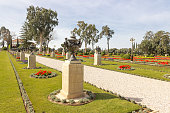 path with trees and shrubs in Bahai garden in Acre