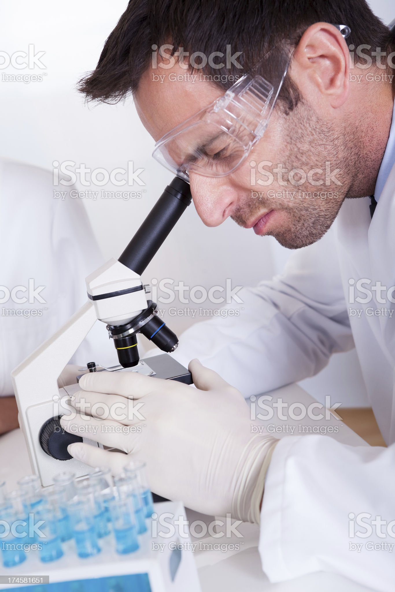 Pathologist or lab technician using a microscope royalty-free stock photo