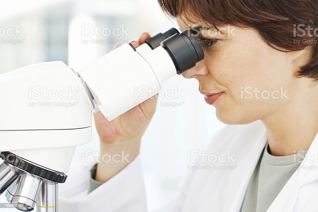 Pathologist Working in Laboratory With Microscope stock photo
