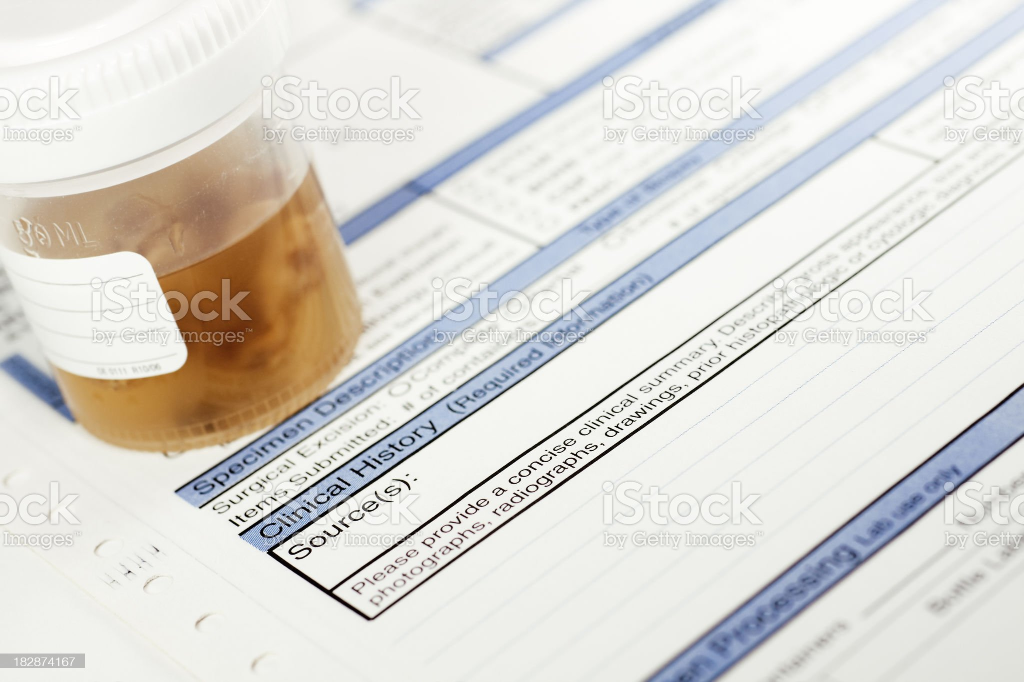 Pathology container with tissue sample and submission form royalty-free stock photo