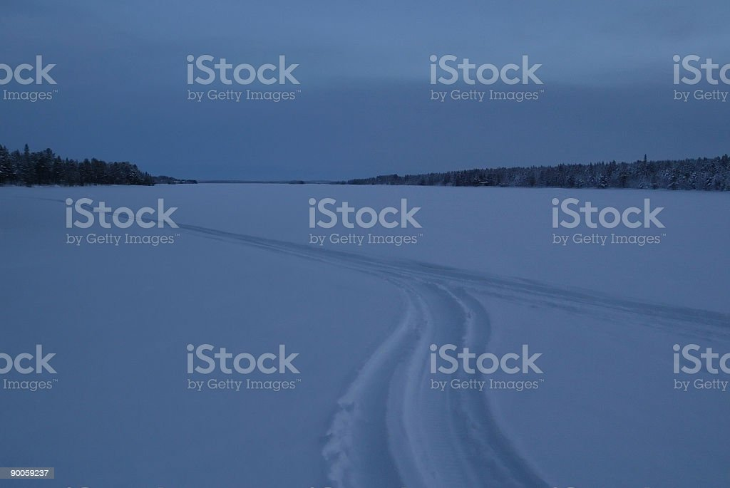 paths in snow lanscape near dark royalty-free stock photo