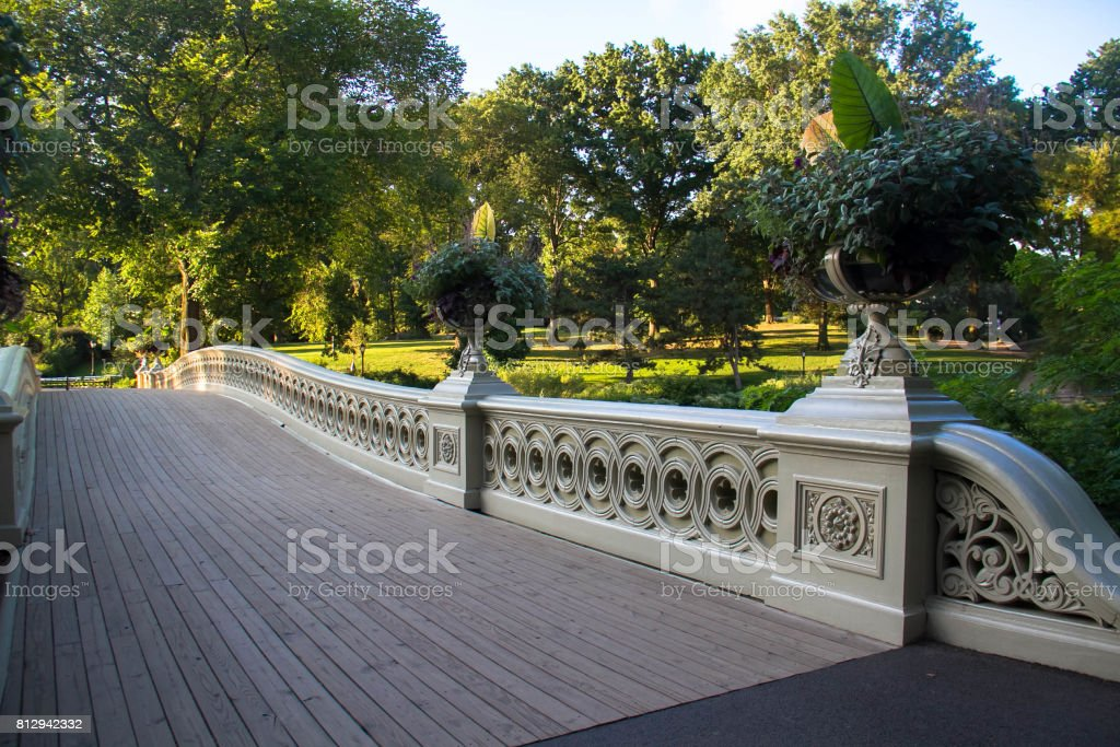 Pathway and fence of Bow bridge and trees at Central Park stock photo