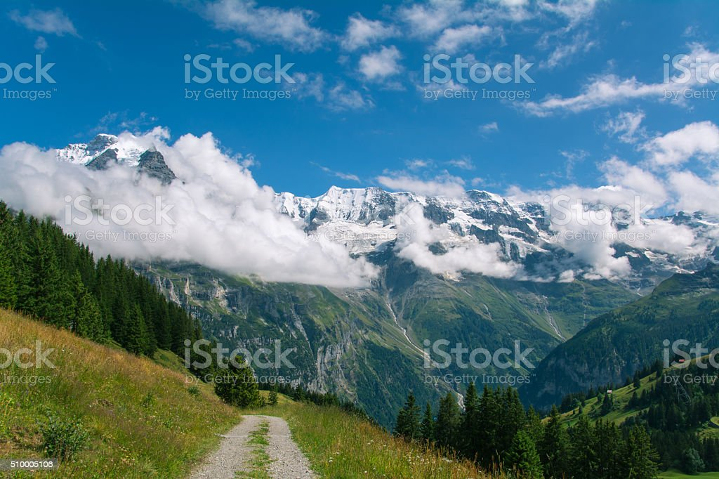 Pathway in Swiss Alps stock photo