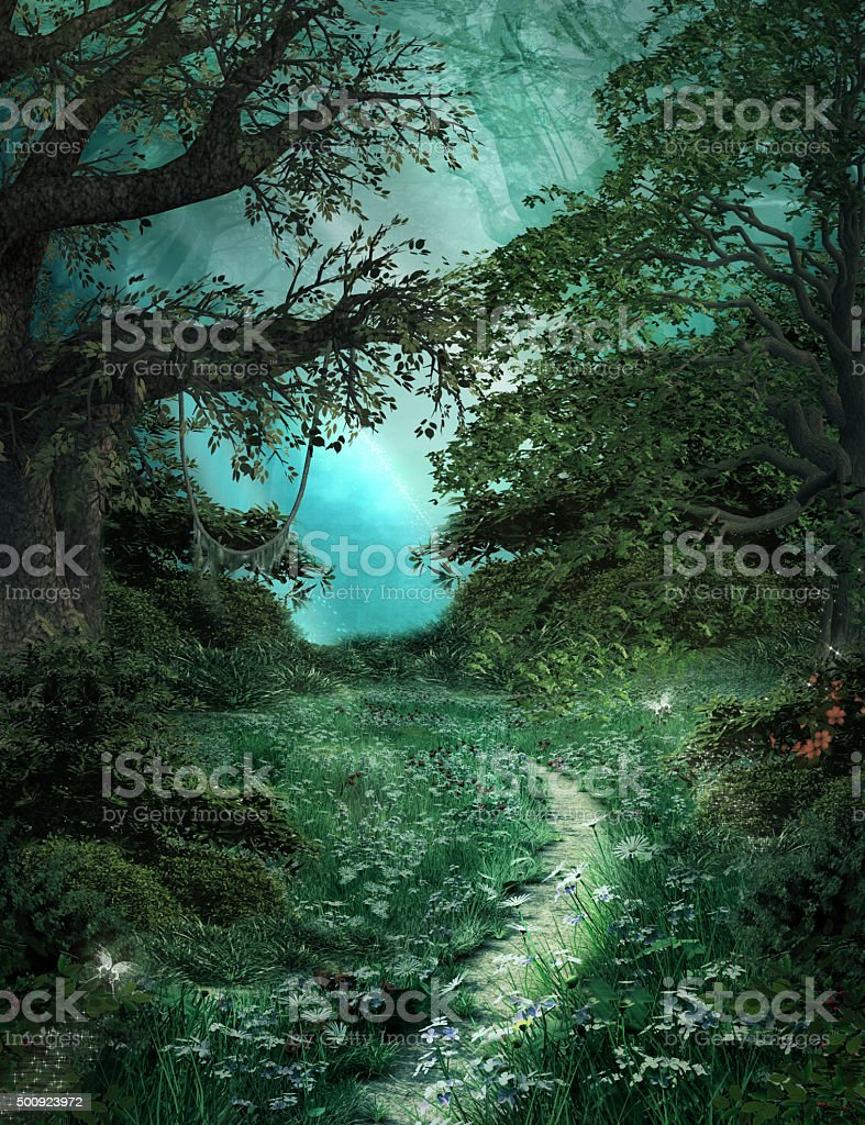 Pathway in the green magic forest stock photo