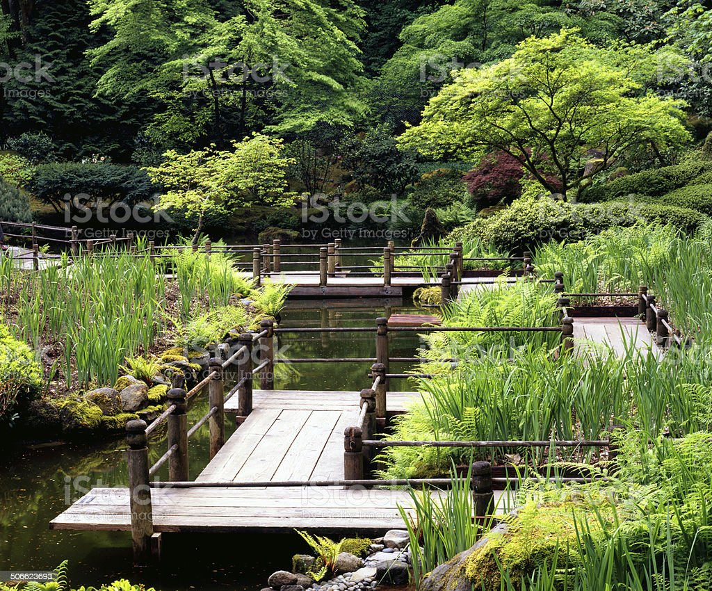 Pathway over pond in Japanese Garden, Portland, Oregon stock photo