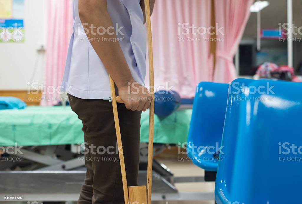 Patian on crutches in hospital on blur background. stock photo