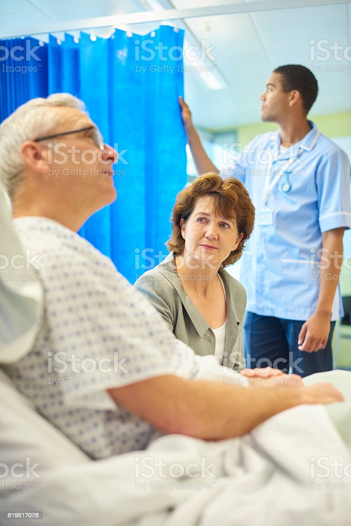 patient and concerned wife stock photo