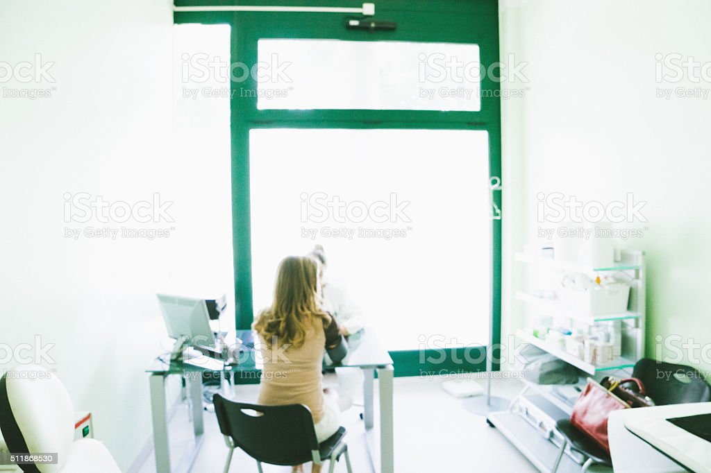 Patient And Doctor In A Medical Room stock photo