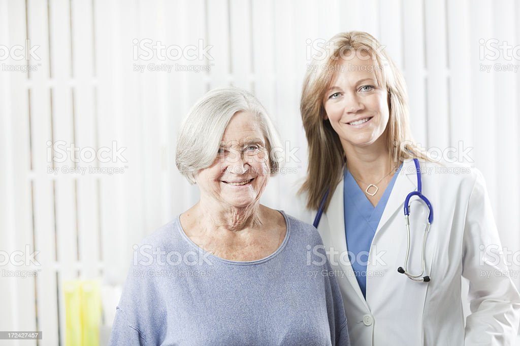 Patient and Doctor in Medical Clinic Office  Hz royalty-free stock photo