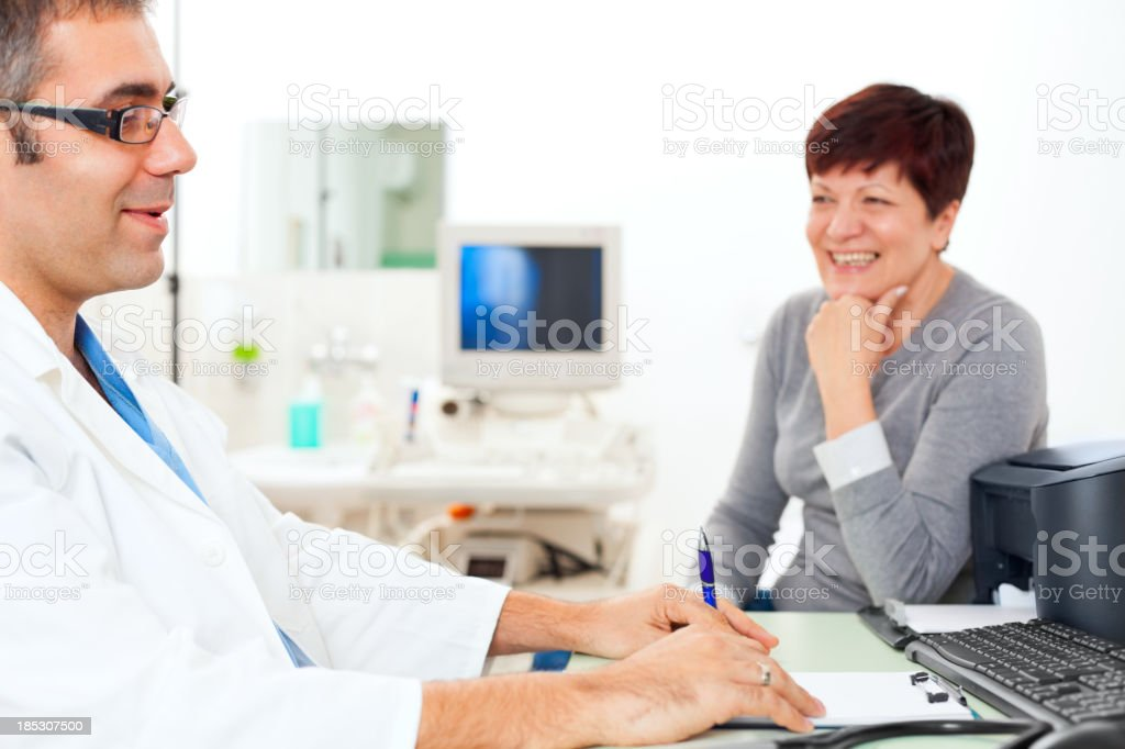 Patient and doctor on ultrasound medical exam royalty-free stock photo
