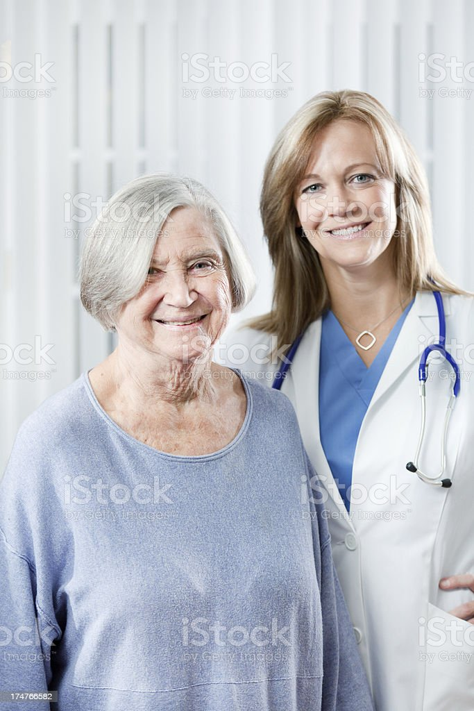 Patient and Physician in Medical Clinic Office  Vt royalty-free stock photo