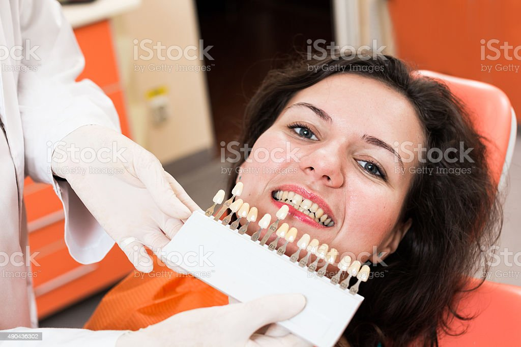 Patient and shade guide stock photo