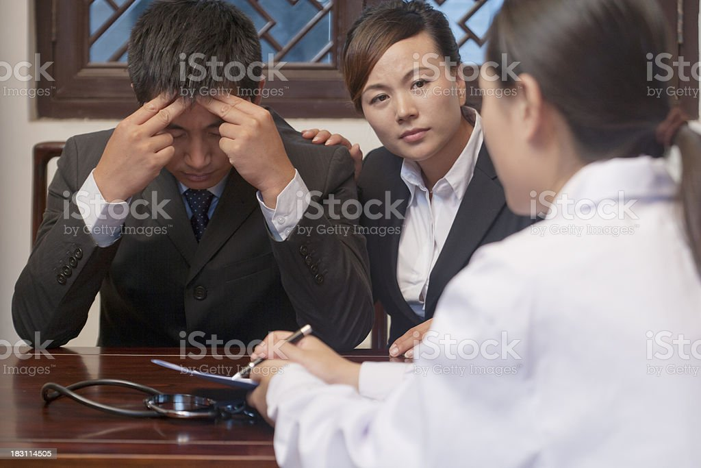Patient and Spouse Concerned about Doctor's Results royalty-free stock photo