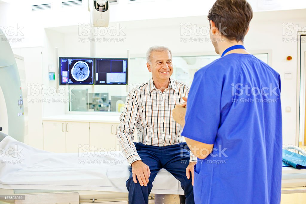 Patient at a computer tomography exam stock photo