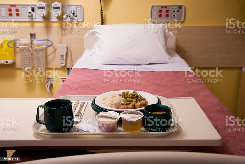 Patient Bed with Dinner Plate in Hospital stock photo