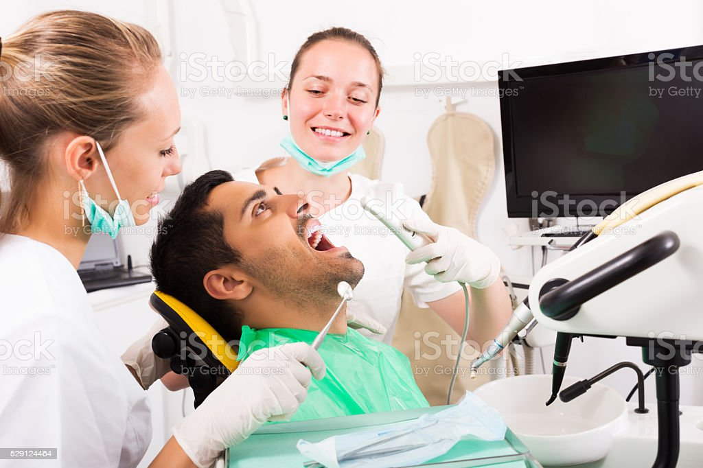 Patient checking the teeth stock photo