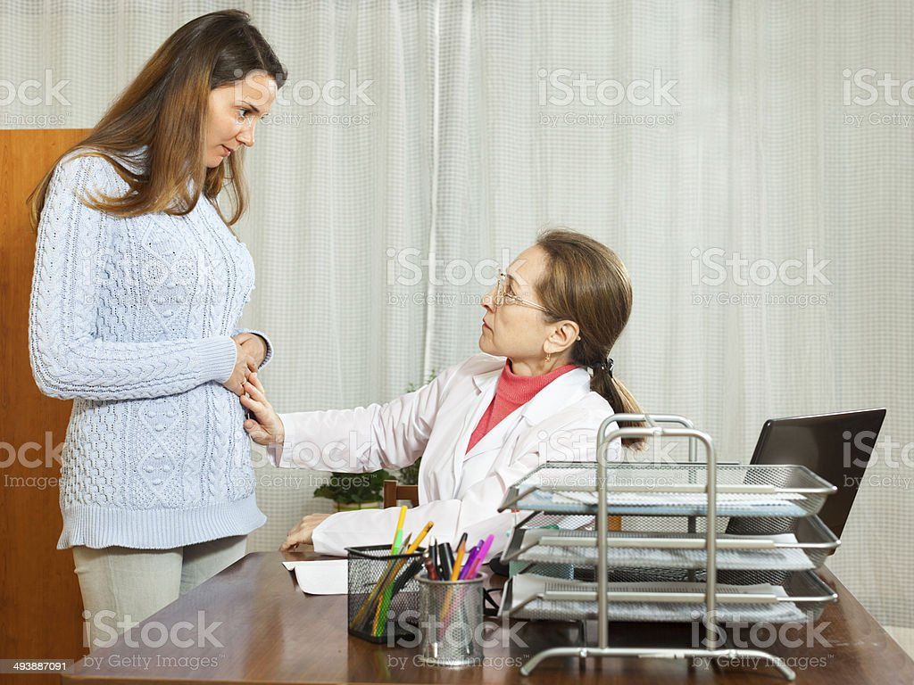 patient complaining of pain in the abdomen  doctor stock photo