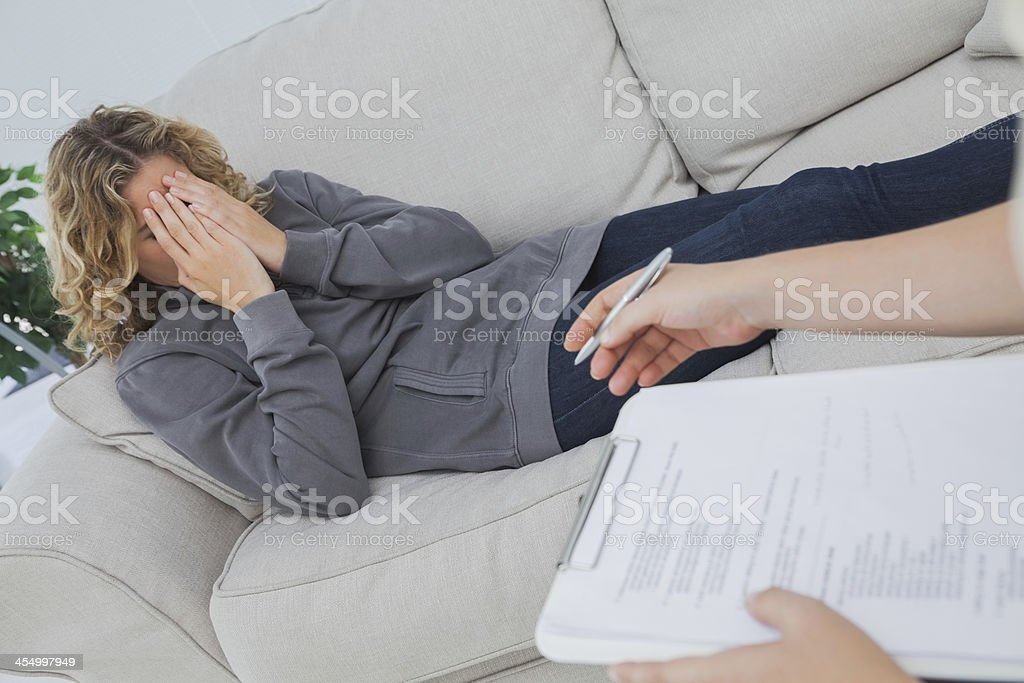 Patient crying on couch stock photo
