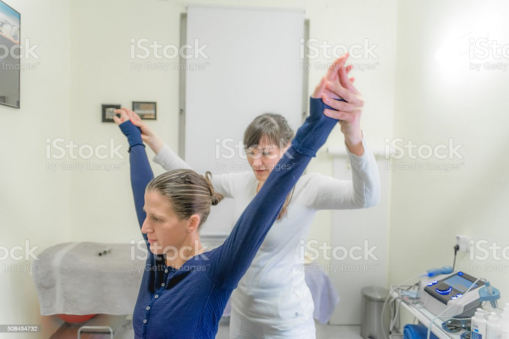 Patient Doing Pilates with Physical Therapists, Rehabilitation After Back Problem stock photo