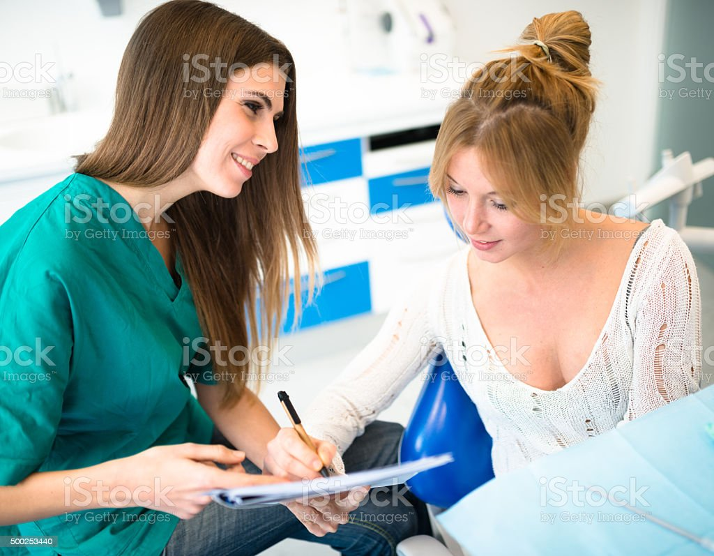 Patient filling the papers of insurance at the hospital stock photo