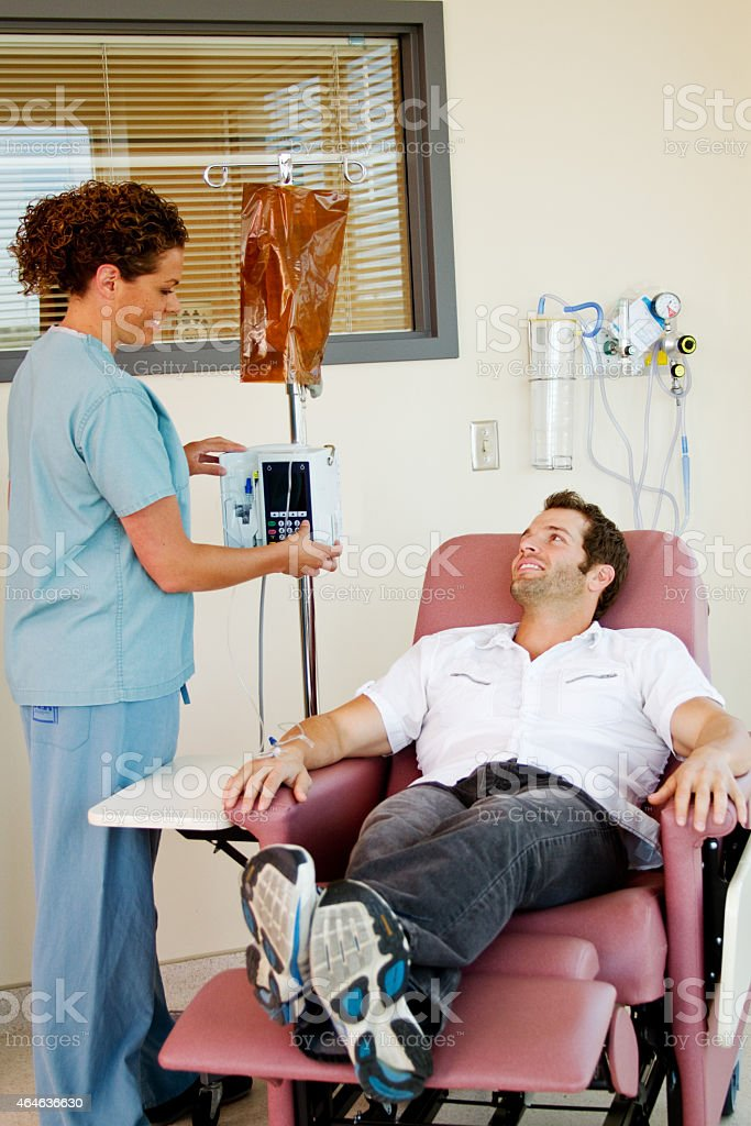 Patient giving nurse a smile stock photo