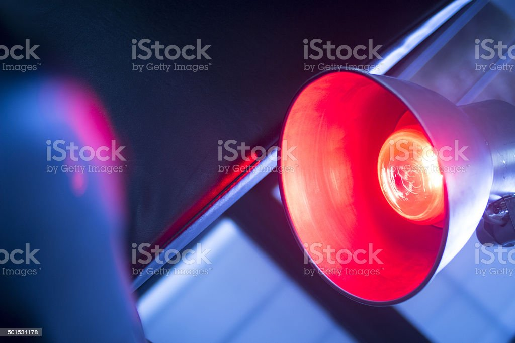 Patient hand in red physiotherapy heat treatment stock photo