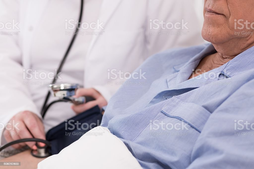 Patient having blood pressure measured stock photo