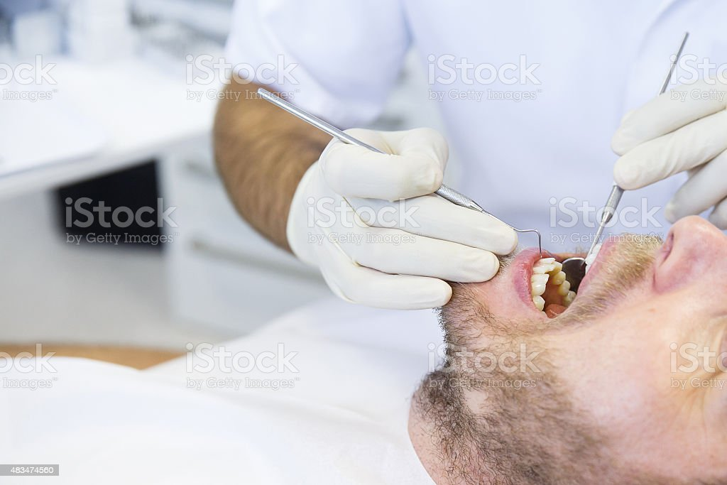 Patient in dental office on regular checkup stock photo