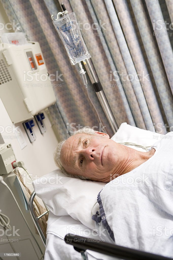 Patient In Hospital Bed stock photo