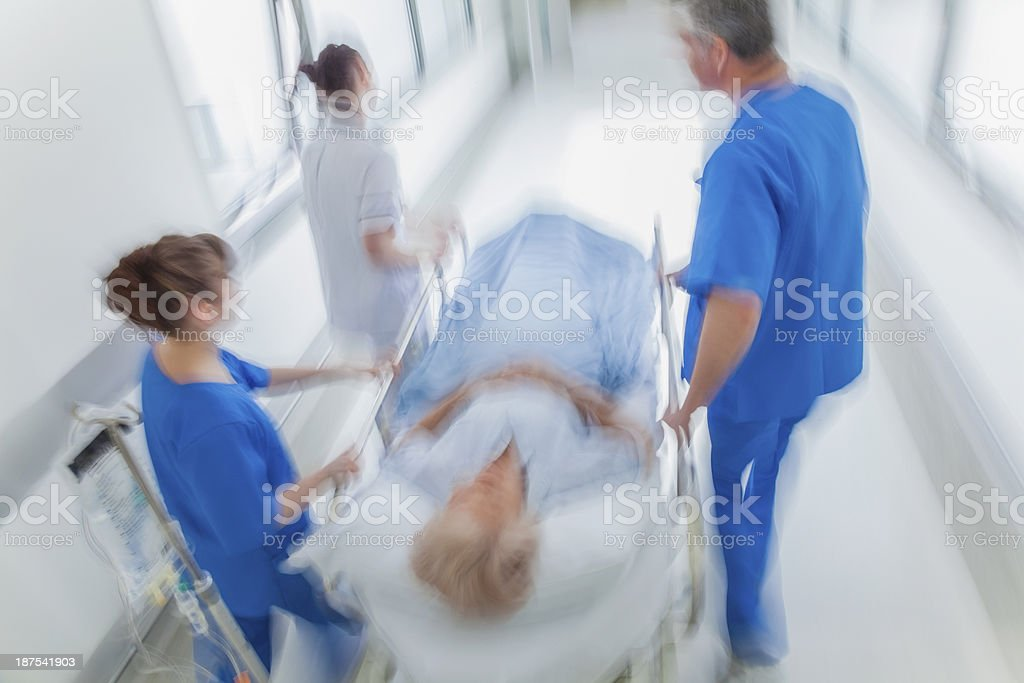 Patient in hospital being rushed on stretcher  stock photo