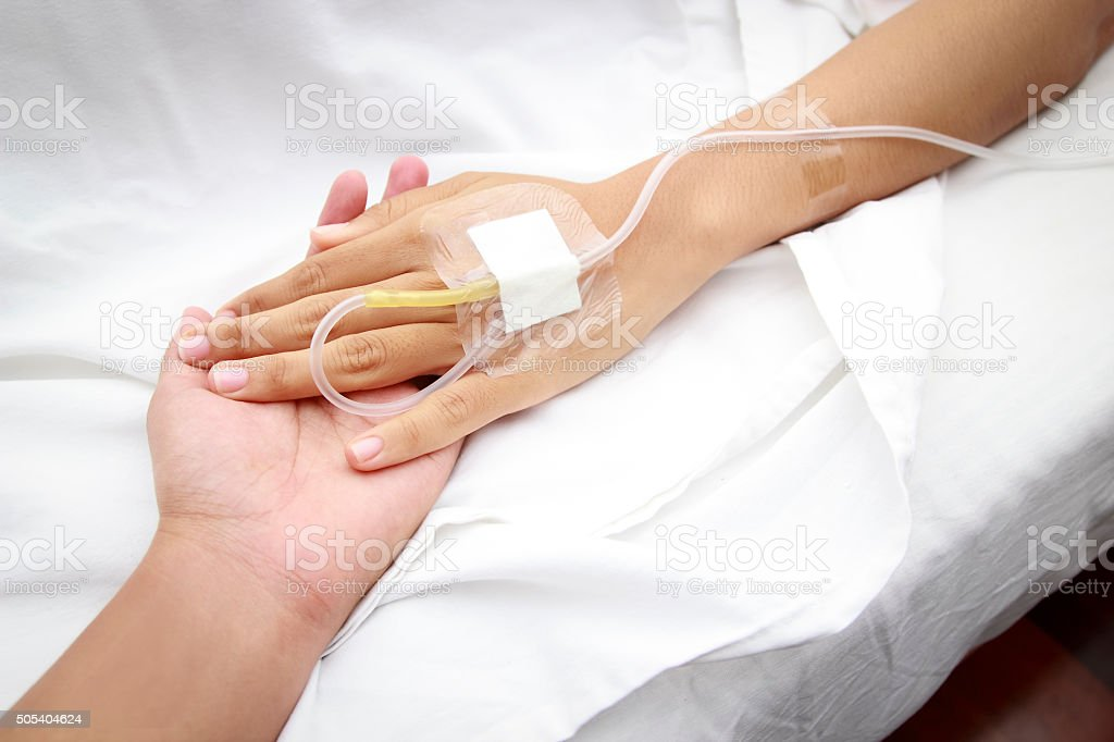 patient in hospital with saline intravenous (iv) stock photo