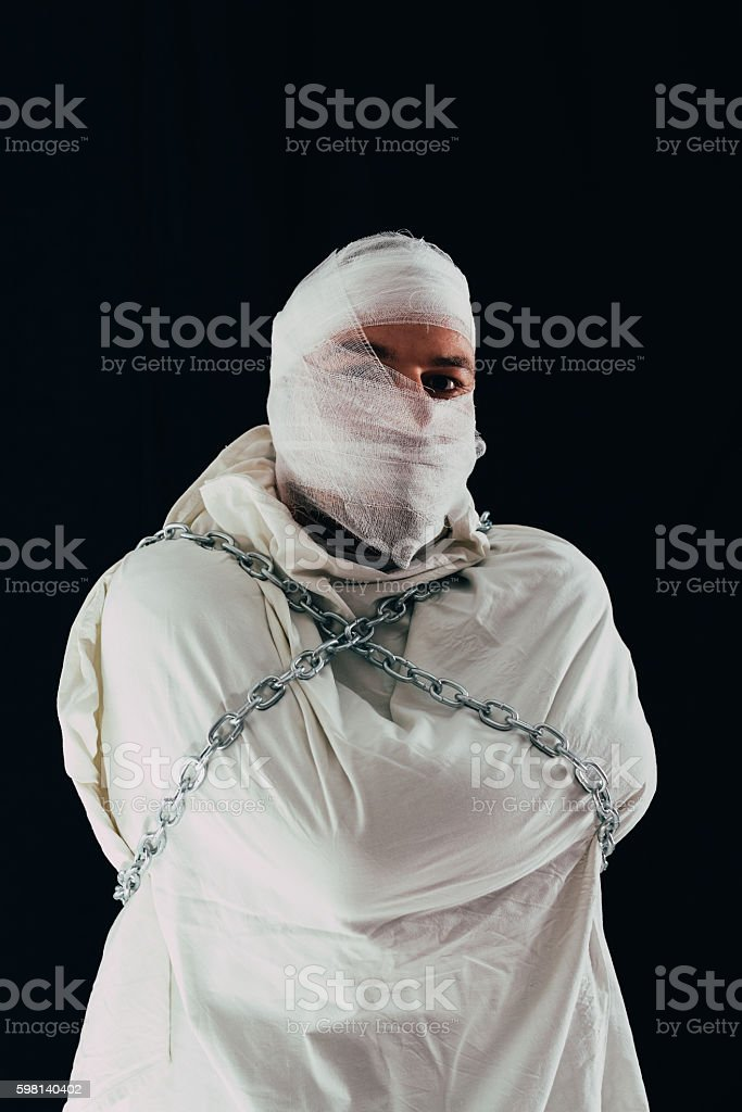 Patient in straitjacket and chains stock photo